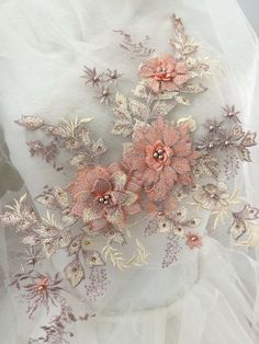 CORAL PRINCESS 3D FLORAL DESIGN EMBROIDERY WITH BEADS AND RHINESTONES ON A MESH.