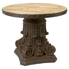 Featuring a regal scrolling base and nailhead-trimmed top, this stunning end table adds classic appeal to the living room or library.  ...