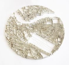 Matthew Picton is a UK-based artist who uses strips of paper from both historic and fictional texts to assemble maps from around the world.