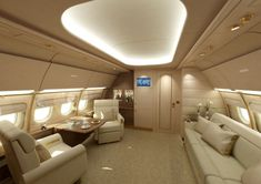 Incredible Custom Private Jet Interiors With Modern White Arm Chairs And Leather Comfort Sofa And Nice Oval False Ceilings With Lights Also White Leather Cushion Inspiring Concept Design