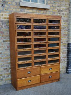 Vintage oak haberdashery cabinet with 24 glass fronted drawers over 4 larger wooden ones. Beautiful period handles.  origin: 1930  year: UK  dimensions: width: 137cm; height: 193cm; depth: 48cm