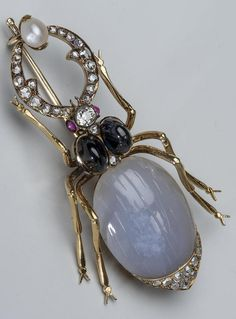 An antique gold, diamond and gem set Stag Beetle brooch, St. Petersburg, Russia, 1908-1917. Set with diamonds, sapphires, rubies and pearl. Length 6.7cm. #antique #brooch
