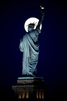 The blue moon rises near torch of the Statue of Liberty as seen from Liberty State Park Picture: AP/Julio Cortez Blue Moon Day, Blue Moon Rose, Park Pictures, Great Pictures, Moon Photos, I Love Ny, World Photo, Dream City, St Thomas