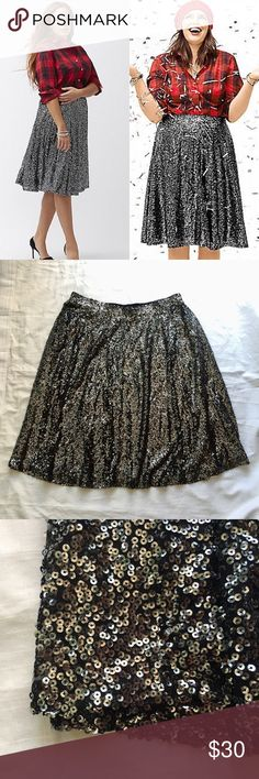 "Lane Bryant Black with Silver Sequins Lined Skirt NWOT Lane Bryant black skirt with silver sequins. Very sparkly and fun. Fully lined. A line skirt with an elastic waist. Waist: 18"" (elastic) Length: 28"" size 18/20. Plus size. Please see photos for more details. A marker was used on tag to prevent return to retail stores. Lane Bryant Skirts Midi"