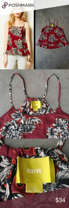 Anthropologie Maeve Silk Red Floral Zaballa Tank Maeve brand tank from Anthropologie, size 8 (medium), in excellent condition! Bold black and white floral print on red background. Spaghetti straps and racerback tank style. Flowy with bottom ruffle. Back has pleat down middle. Cover photo from Anthro website. Please ask any questions. No trades. Make a reasonable offer. Thanks! Anthropologie Tops Tank Tops