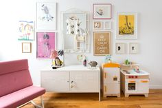 One of the areas that all four girls (the family AND Erica) ended up loving was the gallery wall in the girls' bedroom. It incorporates some of the daughters' favorite art as well as their own, and it's constantly rotating, allowing them to curate their own little collection.
