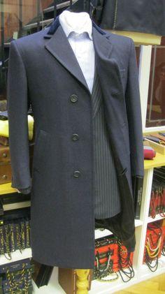 Navy Blue overcoat.