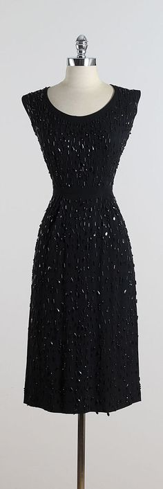 ➳ vintage 1950s dress * black rayon crepe * black jeweled and beaded throughout * metal back zipper * stunning!! condition | excellent fits like medium length 45 bodice 17 bust 38-40 waist 28-29 hips 38 hem allowance 2.75 ➳ shop http://www.etsy.com/shop/millstreetvintage?ref=si_shop ➳ shop policies http://www.etsy.com/shop/millstreetvintage/policy twitter | MillStVintage facebook | millstreetvintage instagram | millstreetvintage 5553/1605