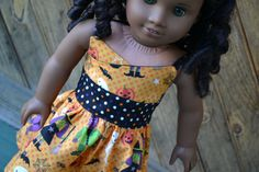 Halloween themed wrap dress by camelotstreasures. Made using the Wrap Top Dress pattern. Get it here http://www.pixiefaire.com/products/wrap-top-dress-18-doll-clothes. #pixiefaire #wraptopdress