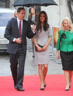 """The Duke and Duchess of Cambridge arrive at the UK premiere of """"African Cats"""" on April 25, 2012 in London, UK. Like a true gentleman, William held the umbrella for Kate as they walked the red carpet..."""