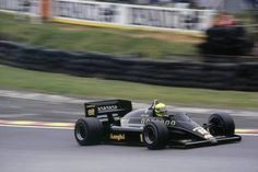 Photographic Print: Ayrton Senna in the Lotus 98T at 1985 British Grand Prix Brands Hatch : 12x8in