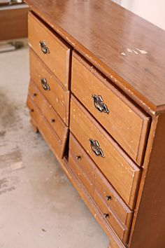 you should really check out this blog and see how they refinished this junker dresser! http://www.bowerpowerblog.com/2010/12/dressier-dresser/