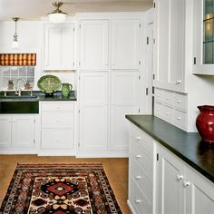 I 39 m seriously feeling soapstone counters with a big for Colonial kitchen cabinet ideas