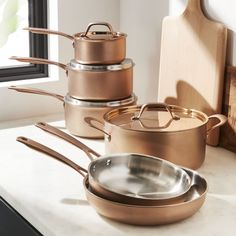 Shop Fleischer and Wolf Bronze Rome Tri-Ply Cookware Set. Stunning for its subtly textured and rose gold matte exterior, this cookware set shows off beautifully while outfitting the kitchen with ten essential pieces. Copper Cookware Set, Cast Iron Cookware, Casseroles, Induction Cookware, Pots And Pans Sets, Bronze, Pan Set, Kitchen Utensils, Kitchen Appliances