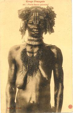 "Translated caption reads: ''French Congo. Old pahouine woman''. Address reads: '' Monsieur L. Lannee - 40 rue Damrecour - Paris 18.' ' Postmarked stamp reads: '' Brazzaville- Congo Français- 14 JUIL 13"". Congo Français. Photograph by J. Audema. Photo ca. 1905"