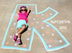 First day of Kindergarten picture. First day of school. Drew out the K with chalk on the driveway and stood on a step ladder for the angle. Added the rest of the text with Text app