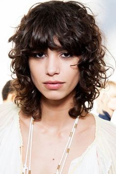 "We can thank model-of-the-moment Mica Arganaraz and her envy-inducing curly shag (that popped up on pretty much every spring 2016 runway) for getting us exited about this refreshing take on fringe. To get the look, Buckett suggests following her lead and keeping your bangs long. ""Start longer than shorter and twist small pieces and cut down to make a scattered or fringy look,"" he says. ""Make them thick enough so they look like bangs and not shorter curly bits around the face.""  #refinery29…"