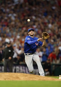 Kris Bryant of the Chicago Cubs throws to first for the final out in of Game 7 of the 2016 World Series against the Cleveland Indians at Progressive...