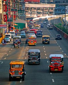 Manila: Jeepneys are the most common form of public transport throughout the many islands of the Philippines. The drivers will slow down enough to enable the passengers to jump on or out..