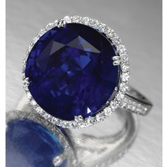 Sapphire and diamond ring. Centring on a circular-cut Ceylon sapphire weighing carats, within a border of brilliant-cut diamonds, the mount and shoulders similarly set, mounted in white gold. High Jewelry, I Love Jewelry, Jewelry Making, Jewellery, Blue Sapphire, Ceylon Sapphire, International Jewelry, Blue Gemstones, Sapphire Jewelry