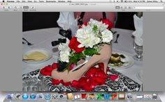 this is the side view of the shoe centerpieces. I covered cake stands with napkins in their motif and put the shoes on top.