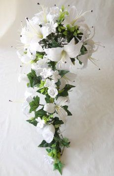 Favorite flower, lilies. Love this wedding bouquet.
