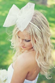 a whimsical bow-topped bridal look made by the Bride  Photography by http://closertolovephotography.com
