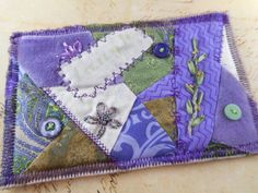 A personal favorite from my Etsy shop https://www.etsy.com/listing/257784438/hand-stitched-crazy-quilt-embroidered
