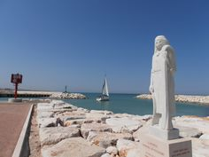 Statue of St Andrea in Senigallia port....