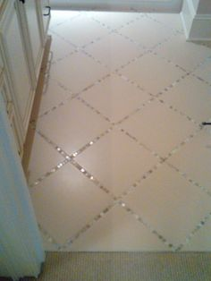"Lay a thin strip of ""backsplash"" tile in between the large tiles, instead of just using grout. pretty!"