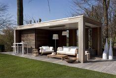 moderne lounge | Bogarden Padoek is een houtsoort die in Belgie veel meer wordt toegepast dan in Nederland. Complimenten voor de mooie moderne stijl. Padoek is in het begin mooi rood en veranderd langzaam naar grijs. Onder een overkapping gaat dit langzam