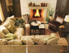 PB: Living room arrangement with fireplace. Love the combination of sofa and chair, old and new, large and small here.