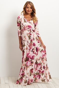 All your favorite floral prints are now available in this one maternity maxi dress! A sash tie detail will show off your bump in style, while 3/4 sleeves are great for any kind of weather. The draped neckline is also super convenient for nursing! With this dress, you can be sure to have a beautiful essential from day to night.