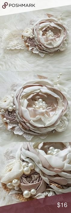 Gorgeous boutique style baby headband Absolutely? gorgeous cream/lace/feathered headband. Worn once for photo shoot. Size will fit 6-12mos Accessories Hair Accessories