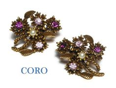 Use code SOCIAL15 for 15% off all purchases over $15, plus FREE shipping on most jewelry! Coro floral earrings, light and dark colored amethyst rhinestone and white seed pearl flower bouquet clip-on 1950s, show stoppers, gold tone. Great #gift for a February birt... #etsygifts #vintage #vjse2 #jewelry