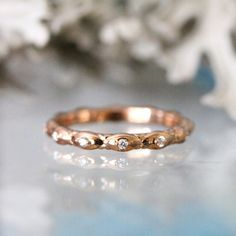 This rose gold leaf and diamond eternity ring: | 43 Stunning Rose Gold Engagement Rings That Will Leave You Speechless