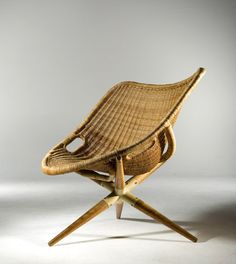 JOSEPH ANDRE MOTTE | Tripod chair, 1949. rotin with metal and wood base