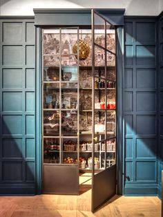 Great wallpapered pantry with glass and steel doors. Ikea's New Sektion Cabinetry - via Vanessa Francis Design