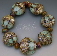 Lampwork beads by Lydia Muell. I love Lydia's stuff and her style, detail, etc in glass... Sweet!
