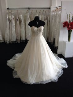 A beautiful Essense gown on display in our boutique