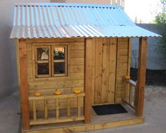 Cute playhouse.  Remember the one we had, like this but with wood/shingle roof…