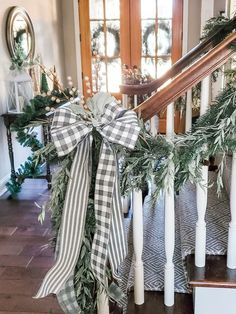Our Christmas garlands from last year! I love the a neutral green look for our family room and dining room. I used to separate Pine and Eucalyptus Garland to create this drapey look. I love buffalo plaid but the gray Buffalo plaid is a little more subtle then the traditional black or red. #LTKhome #LTKunder50 #LTKgiftspo