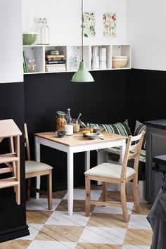 14 Styling Tricks To Steal From The IKEA 2015 Catalog #refinery29  http://www.refinery29.com/ikea-catalogue-styling-tips#slide-3  White, natural wood, black, and mint all jive together in this dining area. And, splitting the wall with two contrasting colors make the ceilings seem higher.