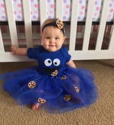 Looking for an adorable Halloween costume for your baby girl. Check out this Easy DIY Cookie Monster outfit that is sure to please.