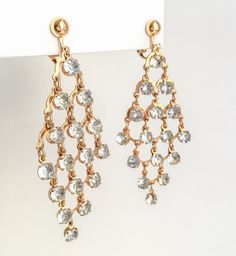 A personal favorite from my Etsy shop https://www.etsy.com/listing/265431222/avon-vintage-chandelier-earrings-gold