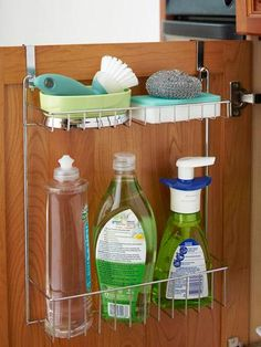Hanging a rack (like the ones made for in showers) on the inside of the cupboard under the sink keeps dish soap and sponges handy.