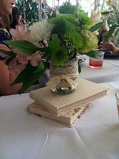 I like the idea of stacking books to make the centerpieces higher! Maybe not the flowers in this shot though.