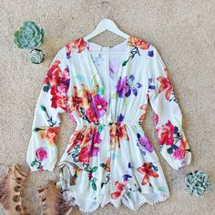 The Lily Romper...adorned with soft boho florals. www.spool72.com