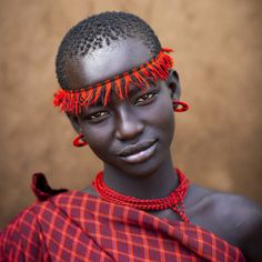 """xtam999: Miss Domoget, Bodi Tribe Woman With Headband, Hana Mursi, Omo Valley, Ethiopia by Eric Lafforgue on Flickr (Larger) """"The Bodi (or Meen) ethnic group live close to the Omo River in southern Ethiopia andhave the Mursi tribe as neighbors to the south. They are pastoralists and agriculturalists,thus livestock plays a large role in the tribe. Along the banks of the river, they cultivate sorghum, maize and coffee."""""""