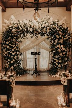 This stunning white rose ceremony arch is giving us major heart eyes | Image by The Light & The Love